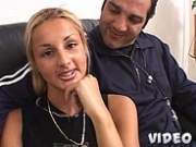Blonde gets banged on the sofa while her man looks on and collects the cash